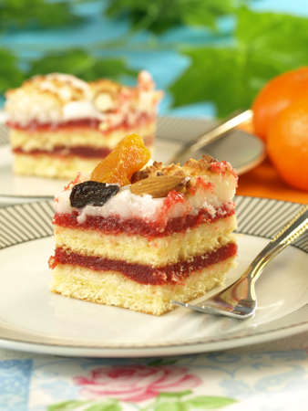 Piece of strawberry cake with dried fruits photo