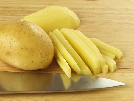 soyulmuş: Ecological potato cut in stripes for chips.