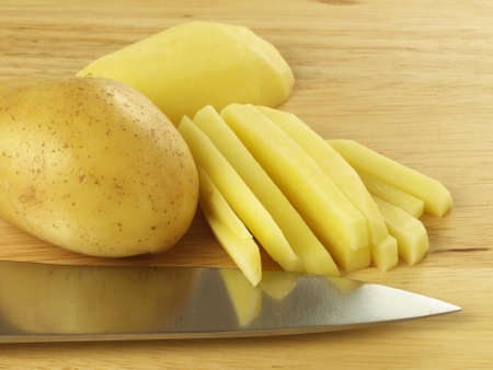potato fries: Ecological potato cut in stripes for chips.