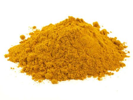asian flavors: Heap of turmeric on isolated white background