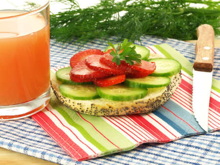 Bun with strawberry and cucumber and fresh juice Stock Photo - 13542372