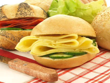 sliced cheese: Close-up of big sandwiches with cheese and vegetables