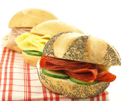 Sandwiches for lunch with salami, cheese and vegetables photo