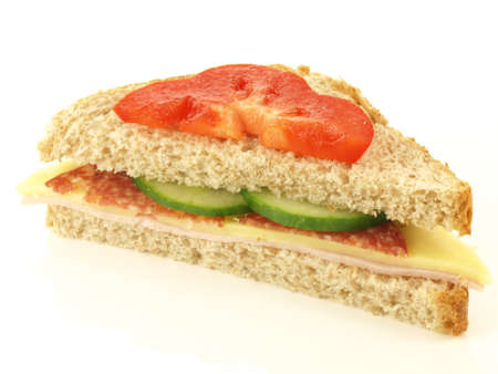 Half of tasty sandwich on white background photo