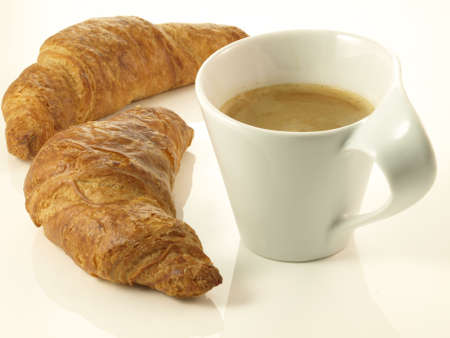 French croissants and cup of fresh coffee photo