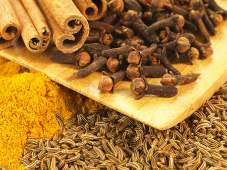 garam: Cumin, curry, cloves and cinnamon in group Stock Photo