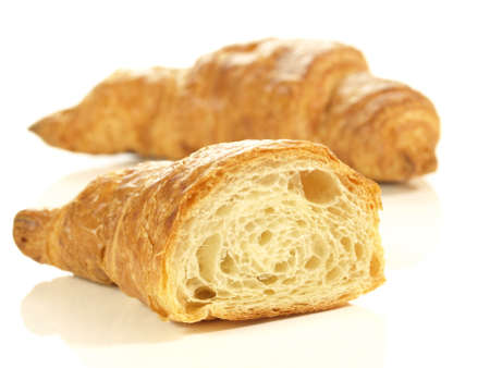 Close up of two croissants for breakfast photo