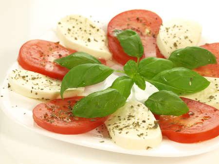 caprese salad: Caprese salad with herbs and leaf of basil