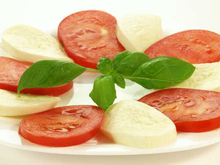 caprese salad: Caprese salad with basil leaf on isolated background