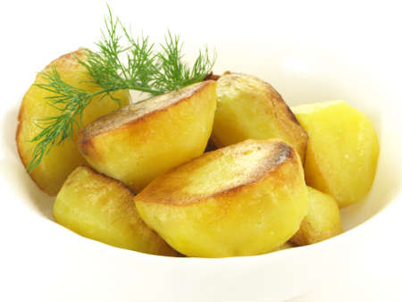 baked potato: Bowl with halves of grilled crusty potatoes  Stock Photo