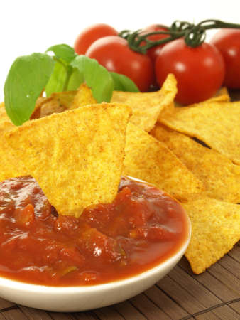 Bowl with mexican salsa and spicy nachos photo
