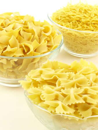 Bowls of tagliatelle, farfalle and polish pasta photo