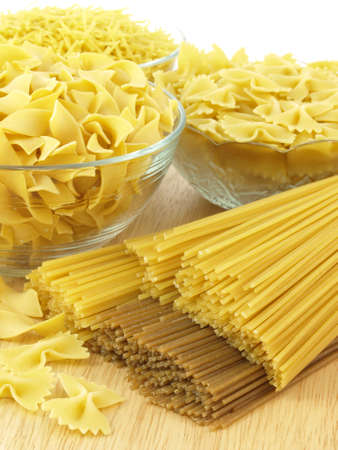 Pasta: tagliatelle, spaghetti, farfalle and polish noodles photo