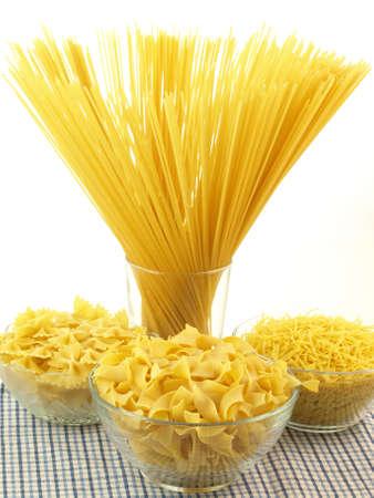 Types of pasta on isolated white background photo