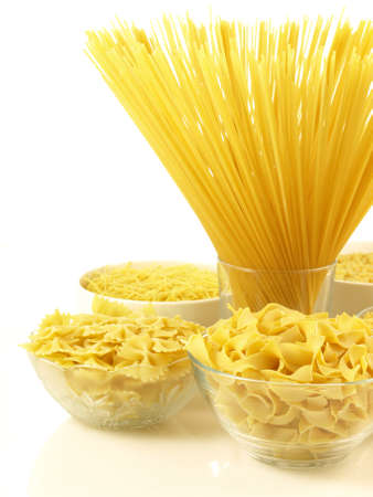 Bowls with various kind of raw pasta photo