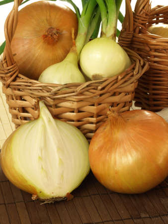 close up of onions in a basket: Ecological healthy onions in basket Stock Photo