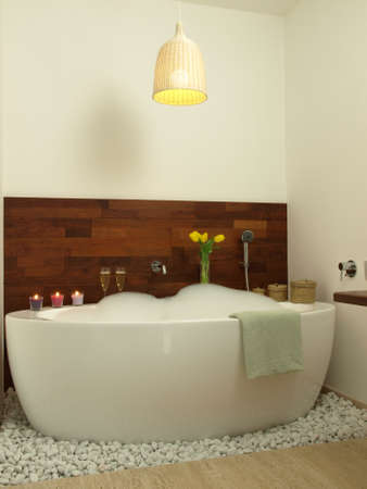 Romantic bath with candles champagne and tulips photo