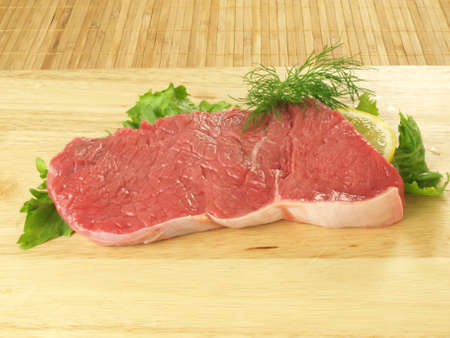Raw fresh beef meat with lettuce photo