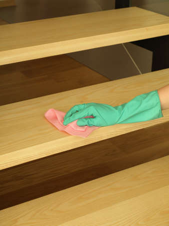 Washing the wooden stairs with pink cloth photo