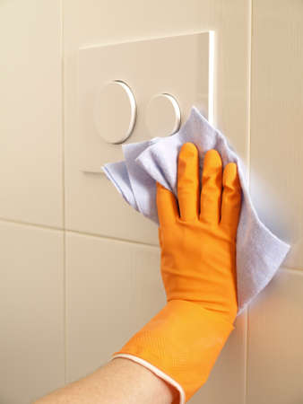 Wiping a bathroom tiles with a soft cloth photo