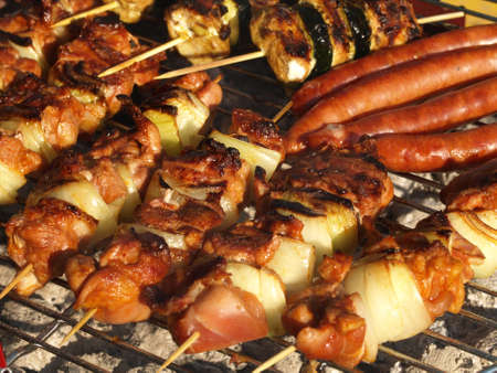 Meat barbecued on grill in the garden photo