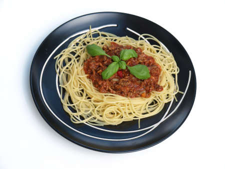 birdeye: Bird-eye view of spaghetti bolognese on isolated background Stock Photo