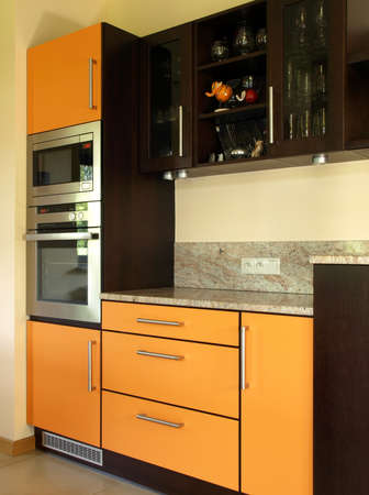 Closeup of cupboards and kitchen appliances, vertical photo