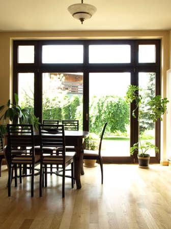 overlooking: Interior of dining room overlooking the garden