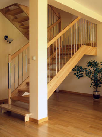 Modern wooden stairs in luxury house photo