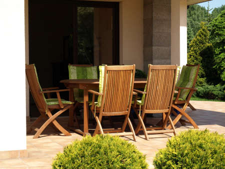 Garden equipment- wooden table and chairs photo