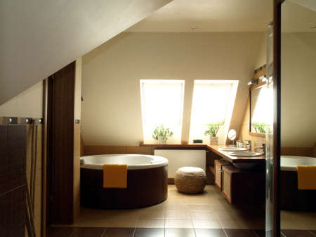 Inside of modern bathroom in the attic photo