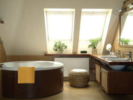 New fasionable bathroom in brown and white colors photo