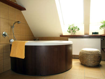 well equipped: Big round bath in new modern bathroom
