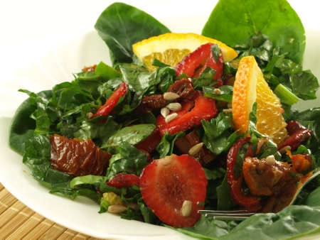 Salad with fresh and dried fruits and vegetables photo