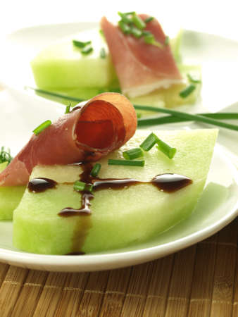 balsamic vinegar: Piece of melon, rolled parma ham and balsamic vinegar