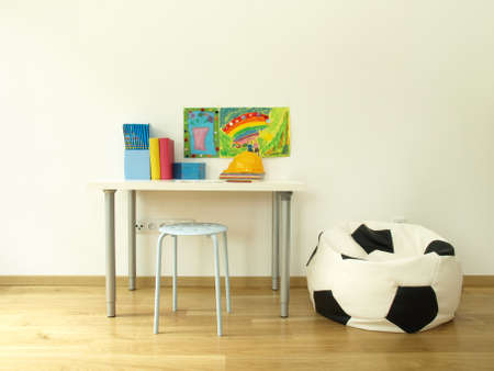 Children room with colorful desk and pouf