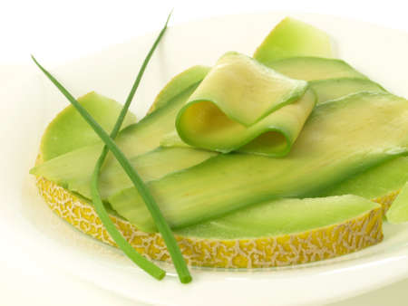 lowfat: Slices of avocado and melon on isolated background