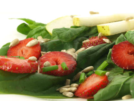 Salad with spinach, fruits and grains, closeup photo