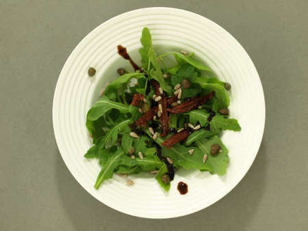 birdeye: Salad with arugula and sun dried tomatoes, bird-eye view Stock Photo
