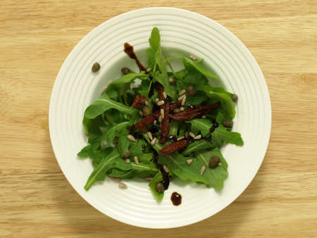 birdeye: Bird-eye view of salad with wild rocket leaves