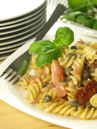 Closeup of fusilli noodles with salmon and capers photo