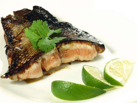 Fillet of salmon fried in soy sauce, isolated photo