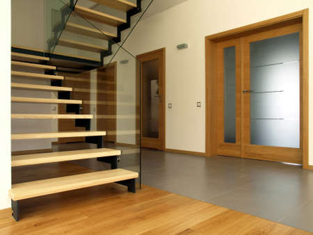 glass door: Wooden and glass stairs in the modern house interior Stock Photo