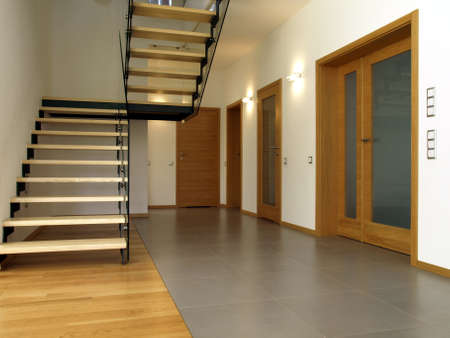 Glass and wooden stairs in the modern house interior photo