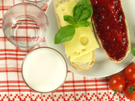 jam sandwich: Baguette with jam and yellow cheese for breakfast