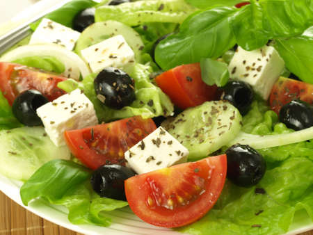 Closeup of healthy salad with feta and olives photo