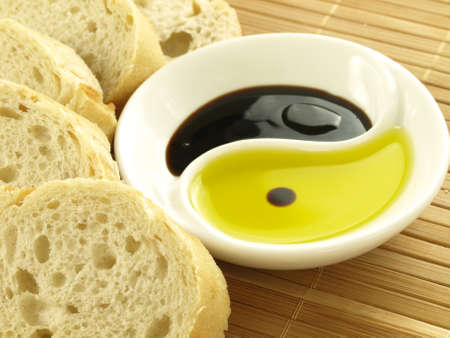 Fresh baguette, olive oil and balsamic vinegar photo