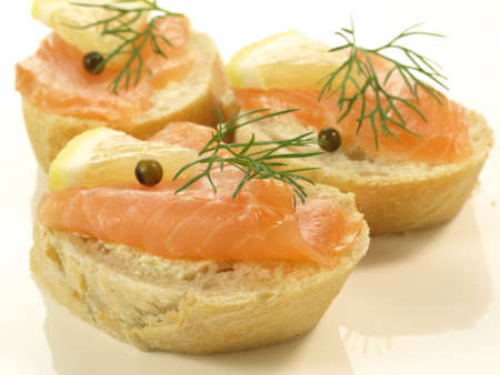 lowfat: Slices of baguette with salmon, lemon and pepper