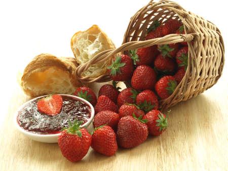 Ripe fresh strawberries and sweet homemade jam photo