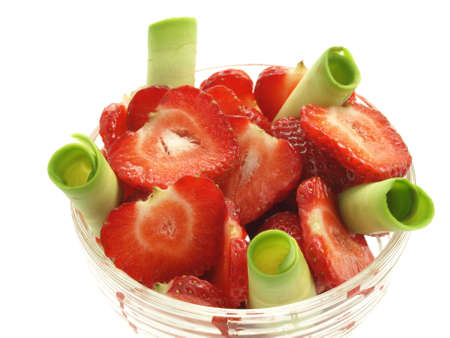 Closeup of strawberries and avocado slices on isolated background photo